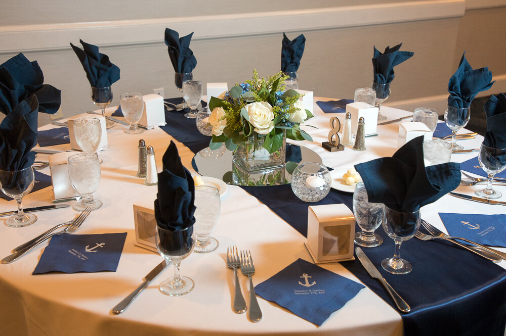 Elegant white and navy blue table setting at the Annapolis Waterfront Hotel in Annapolis, Md.