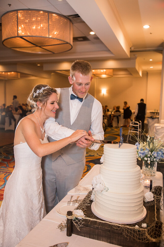 Cake cutting during the wedding reception at the Annapolis Waterfront Hotel.