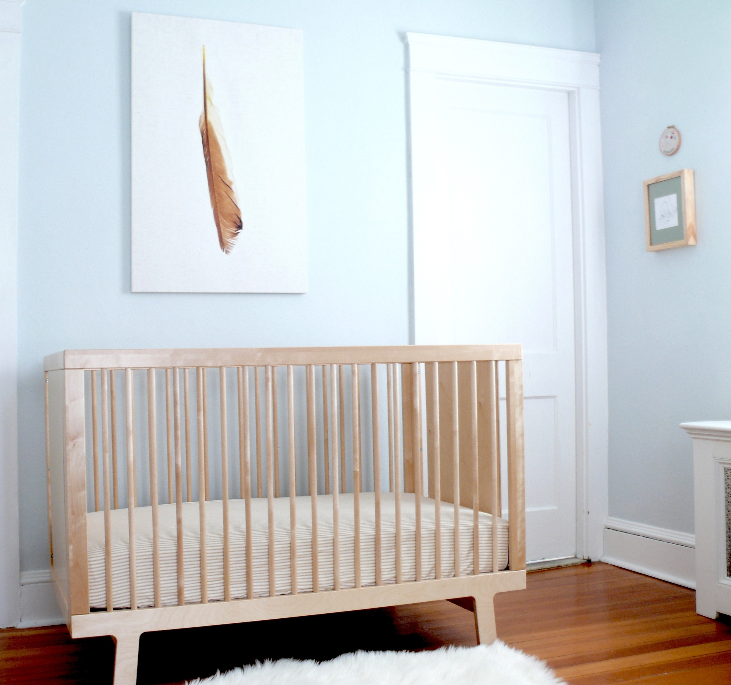 Light blue nursery with feather canvas