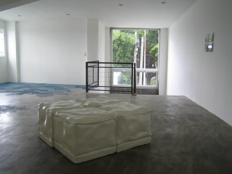 """ottomans with invisible column"" fiberglass, hydrostone, enamel paint  48 x 48 x 24 in  1998"