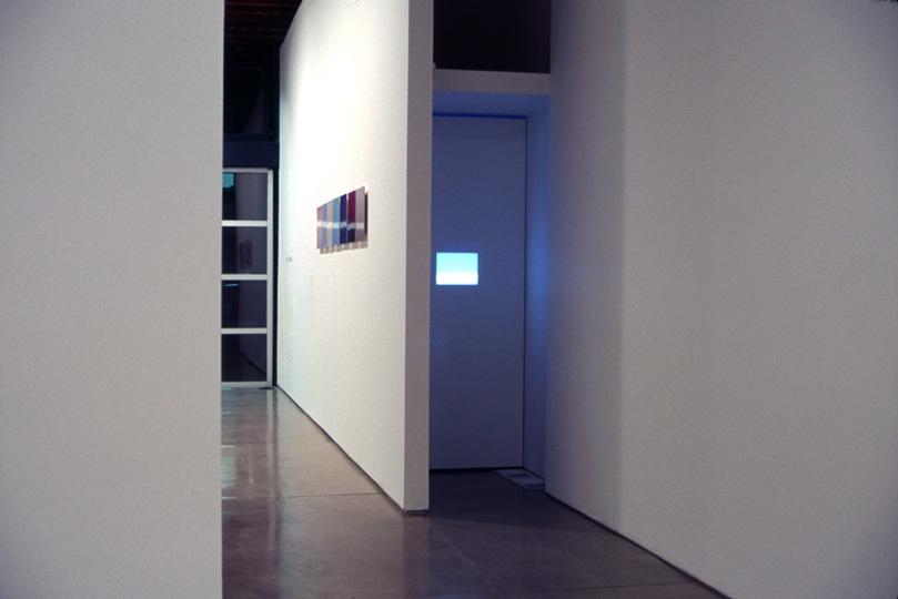 """Mia-jfk"", video installation 8 min loop rear projected on screen (10"" x 10"" wall opening) 2003"