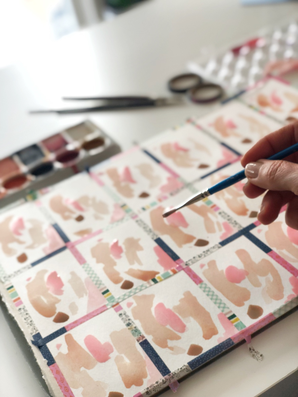 Use watercolor paints that are in the same color family