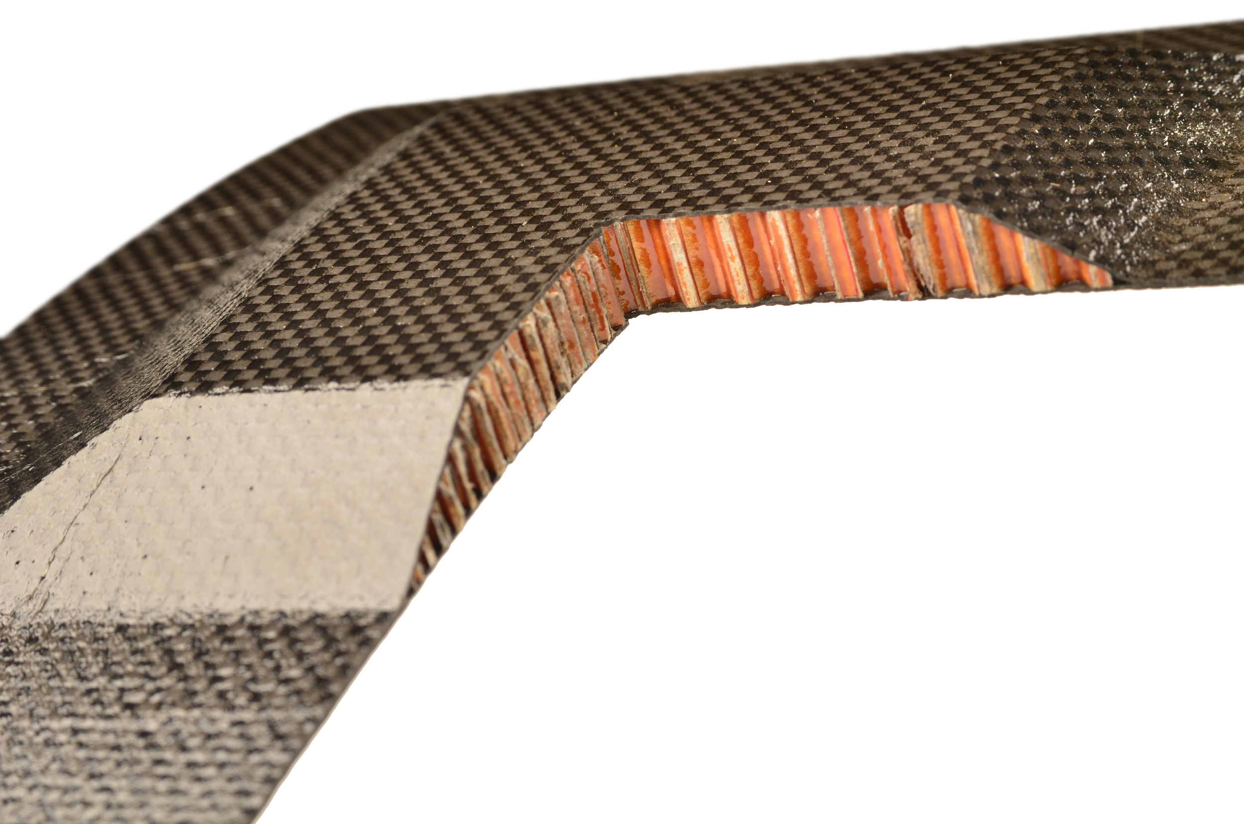 Honeycomb reinforced carbon fiber panel cut to show cross section