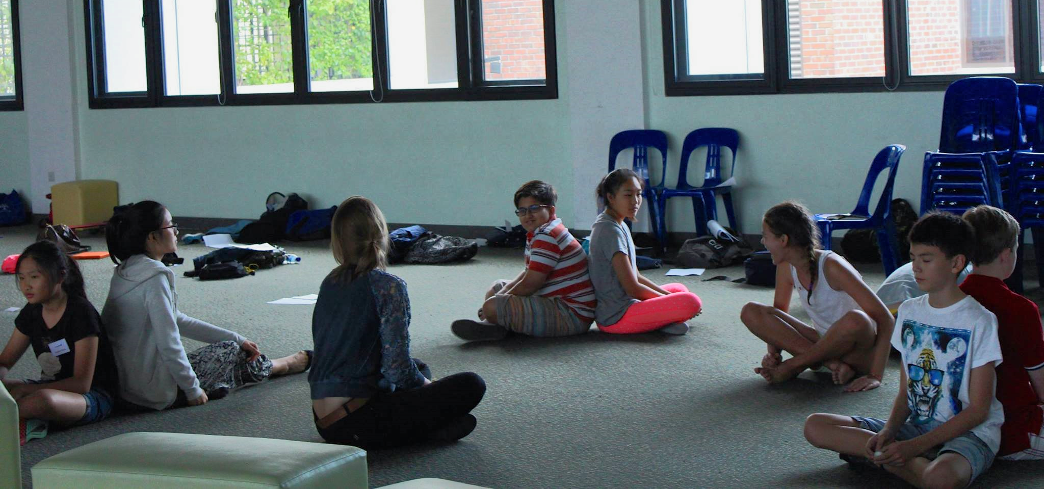 The mind changes the brain changes the mind: mindfulness for young people in action. A beautiful and engaging and powerful session, handing over a tool that in my eyes could well transform a young person's life on its own. Here I have the students sit back to back and practise focussing in on breath, synchronising breath with a partner, and becoming aware of their own, and another persons' body.