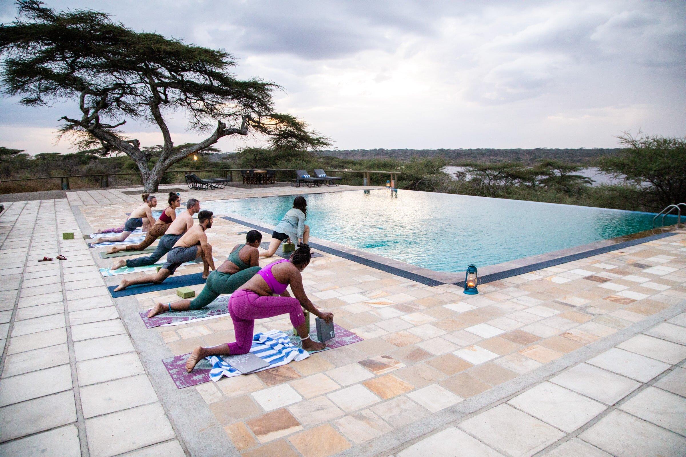 Above Safaris Responsible Travel Yoga Poolside in Tanzania.jpg
