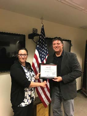 VP, Operational Solutions, Vern Tubbs Presents Kristin Pitts with her Employee of the Quarter Certificate.
