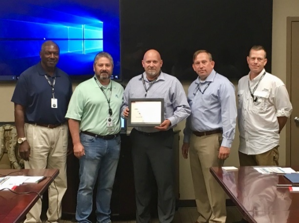 Larry Benedict receives his Employee of the Quarter Certificate. Pictured Left to right: Dr. Maurice Pickett and Yorktown's Team including Scott McDonough, Larry Benedict, Patrick Rousey, and Nick Fuller.