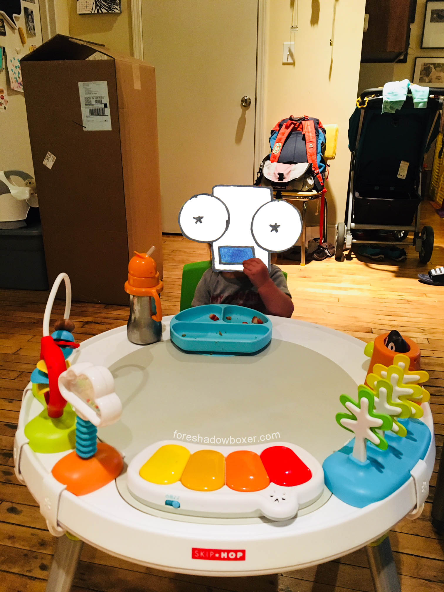 Toys shown are removable; we remove them all when a bigger play/dining/coloring surface is needed.