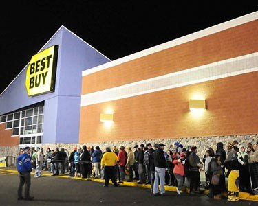 After a night of camping outside of Best Buy, people line up for Black Friday sales.