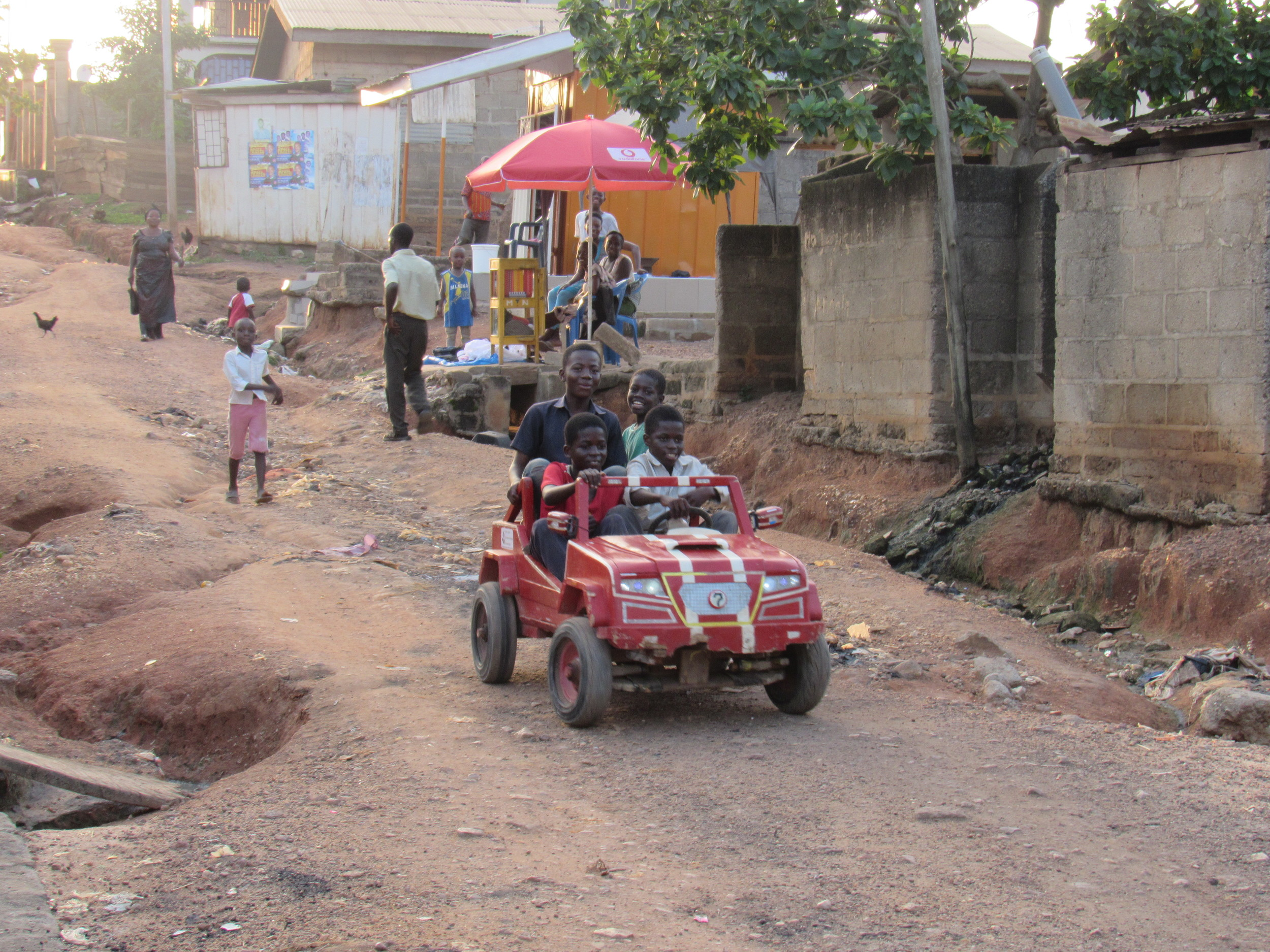 Some kids built a little car and were daredevils riding down a less than stellar road outside our house.