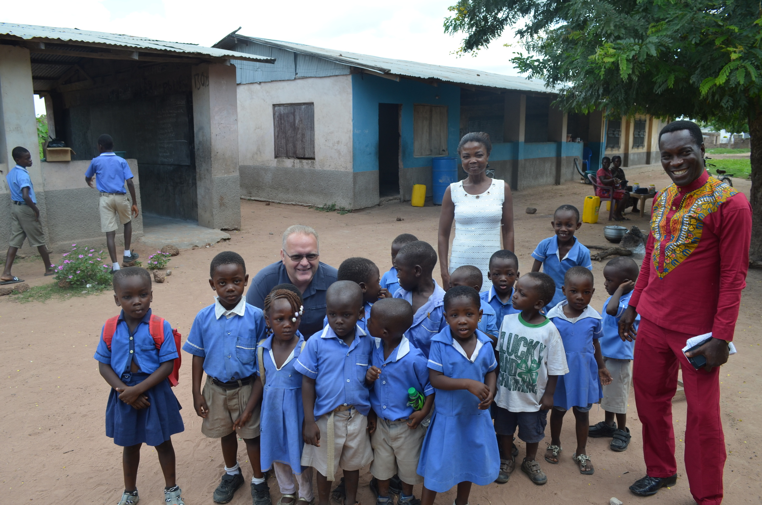 Brother Paul, Brother Jeff, the teacher, and an elementary school class.