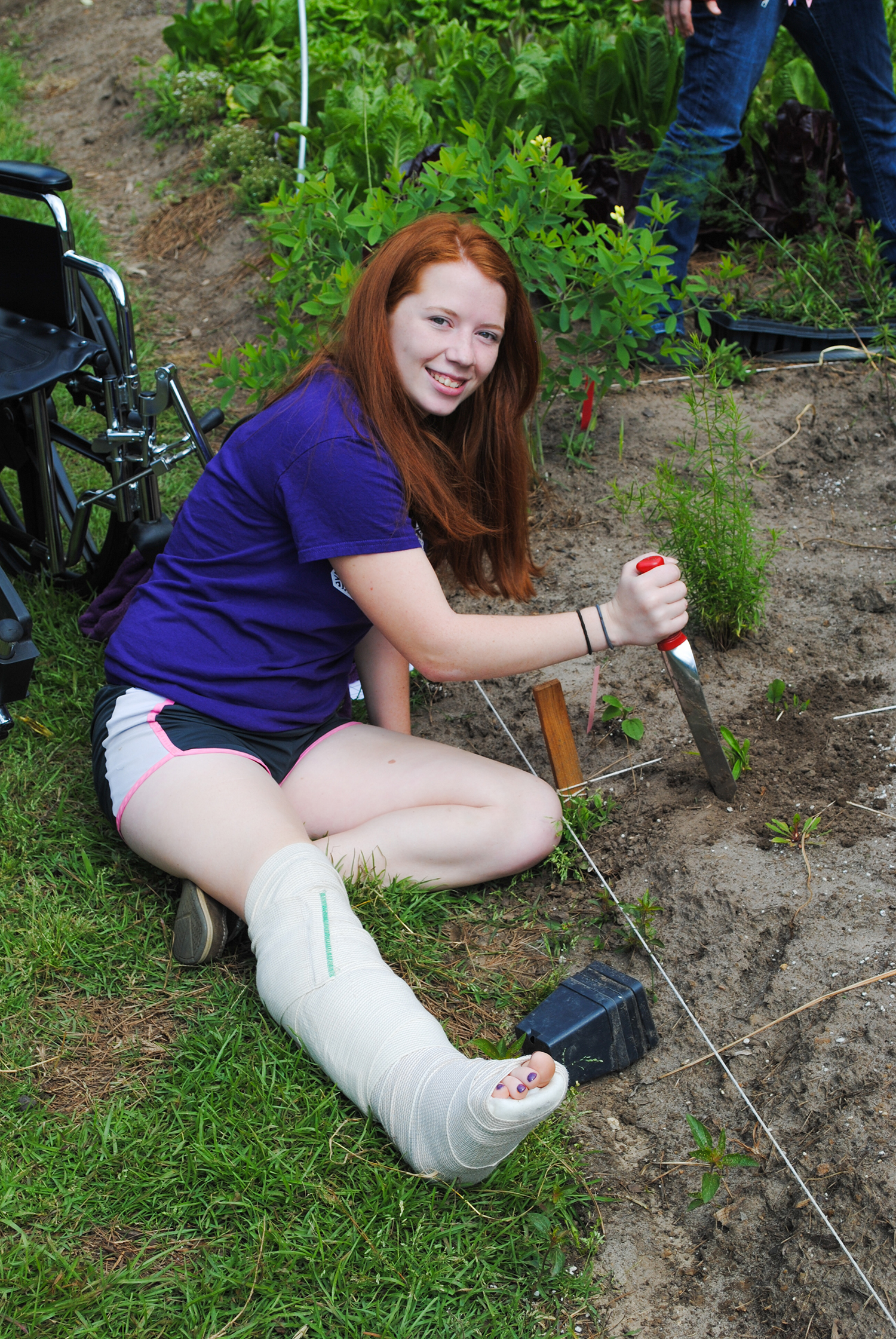 Even a broken leg doesn't stop students like Cierra from helping plant!