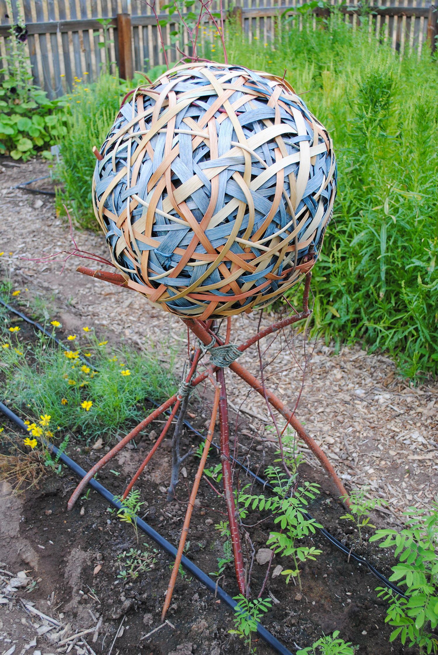 A sphere made from dyed strips of wood demonstrates that the craft isn't just limited to cloth.