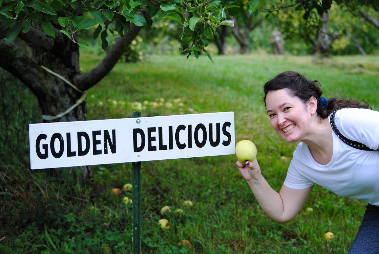 Karen modelling a 'Golden Delicious' apple.