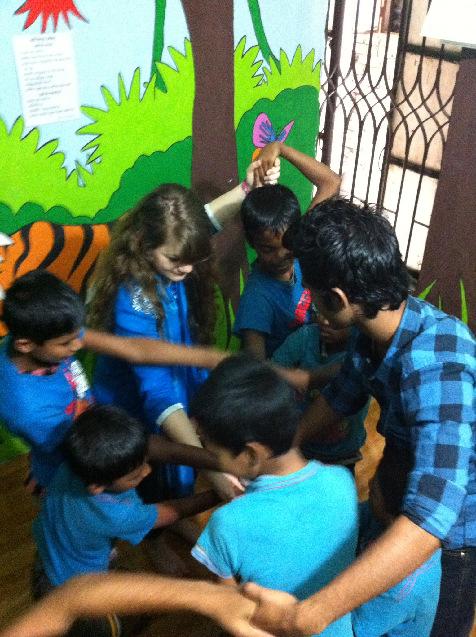 Playing a game of 'Human Knot' at the Smart Kids Center