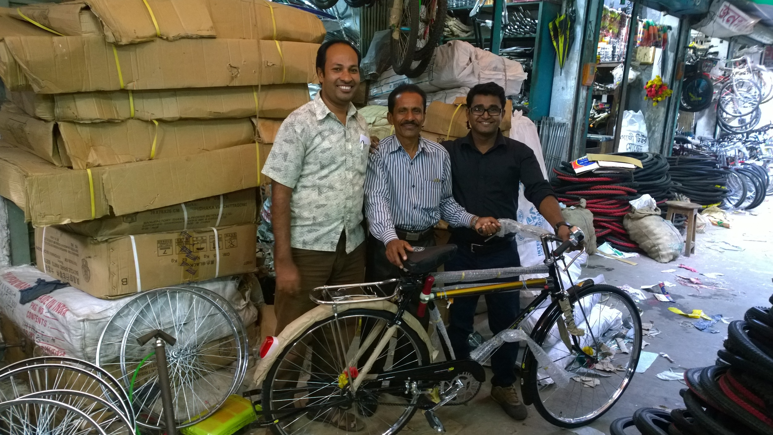 A rural pastor with his new bike, paid for through Equip