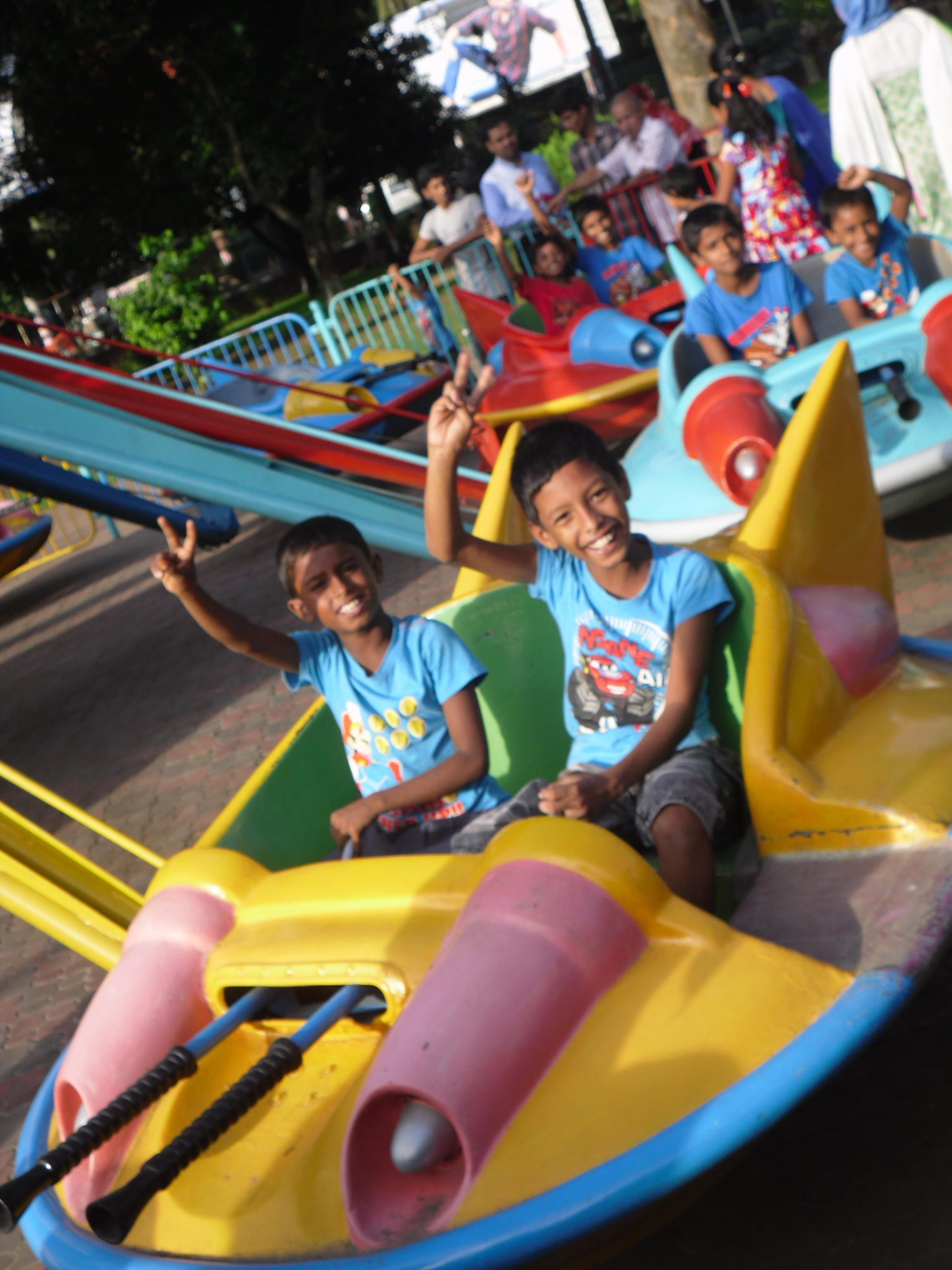 Enjoying the rides at the amusement park