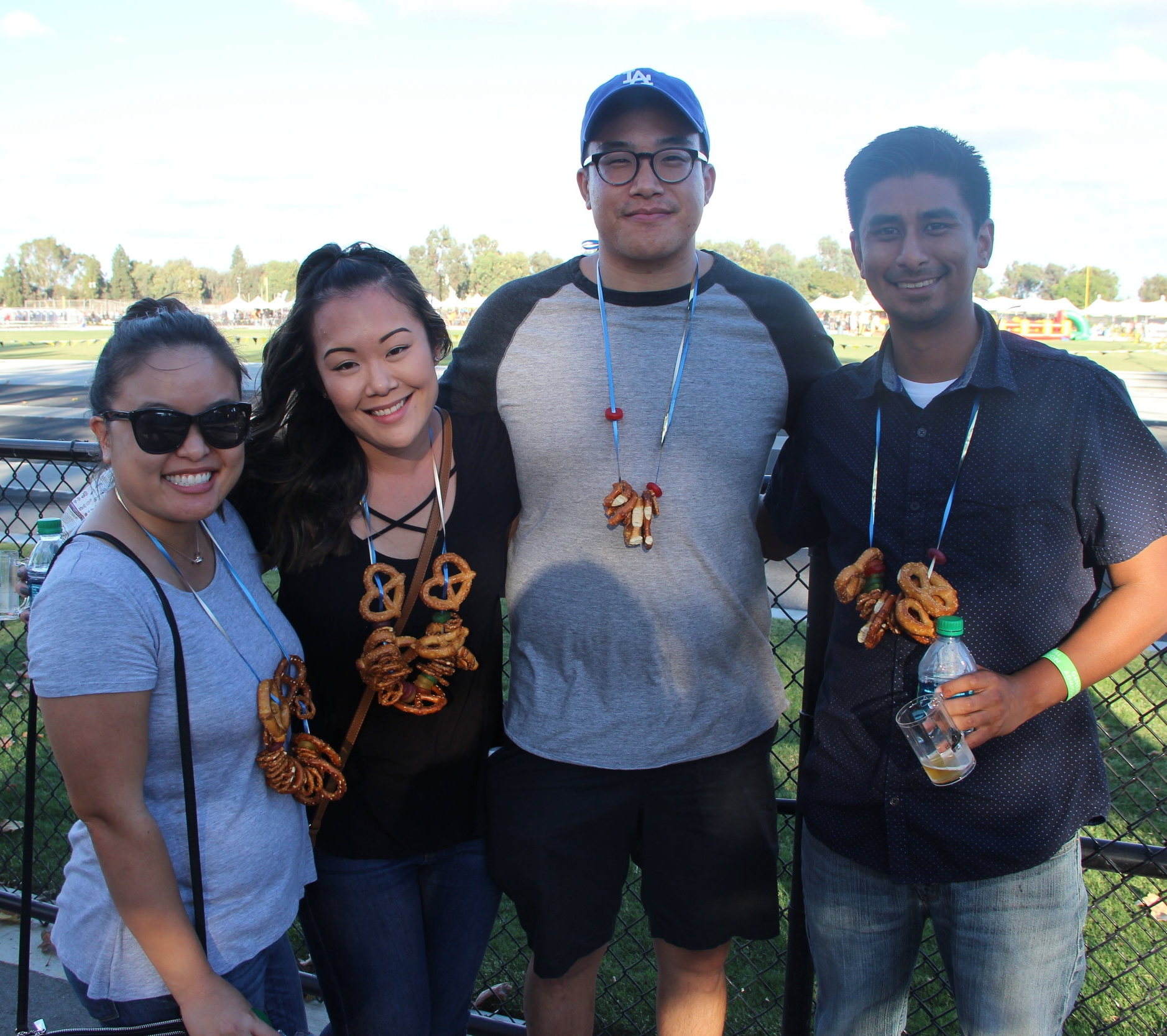 Christina Khong (far left) wears a matching pretzel-and-lifesavers necklace with her friends.