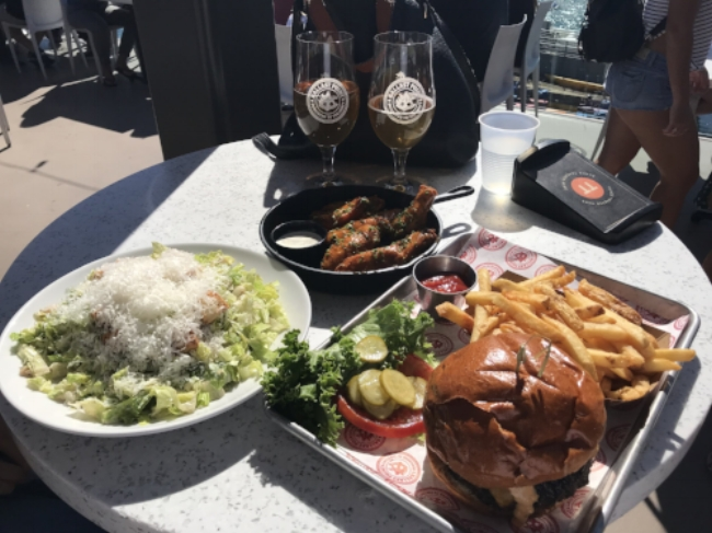 Whether it's a classic caesar salad, tangy buffalo wings, or a traditional burger, you're sure to the perfect meal at Ballast Point.