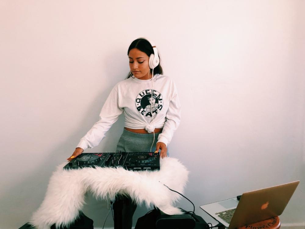 Jennifer Arriaga showing off her DJ skills.  Photo Credit: Jocelyn Ruiz