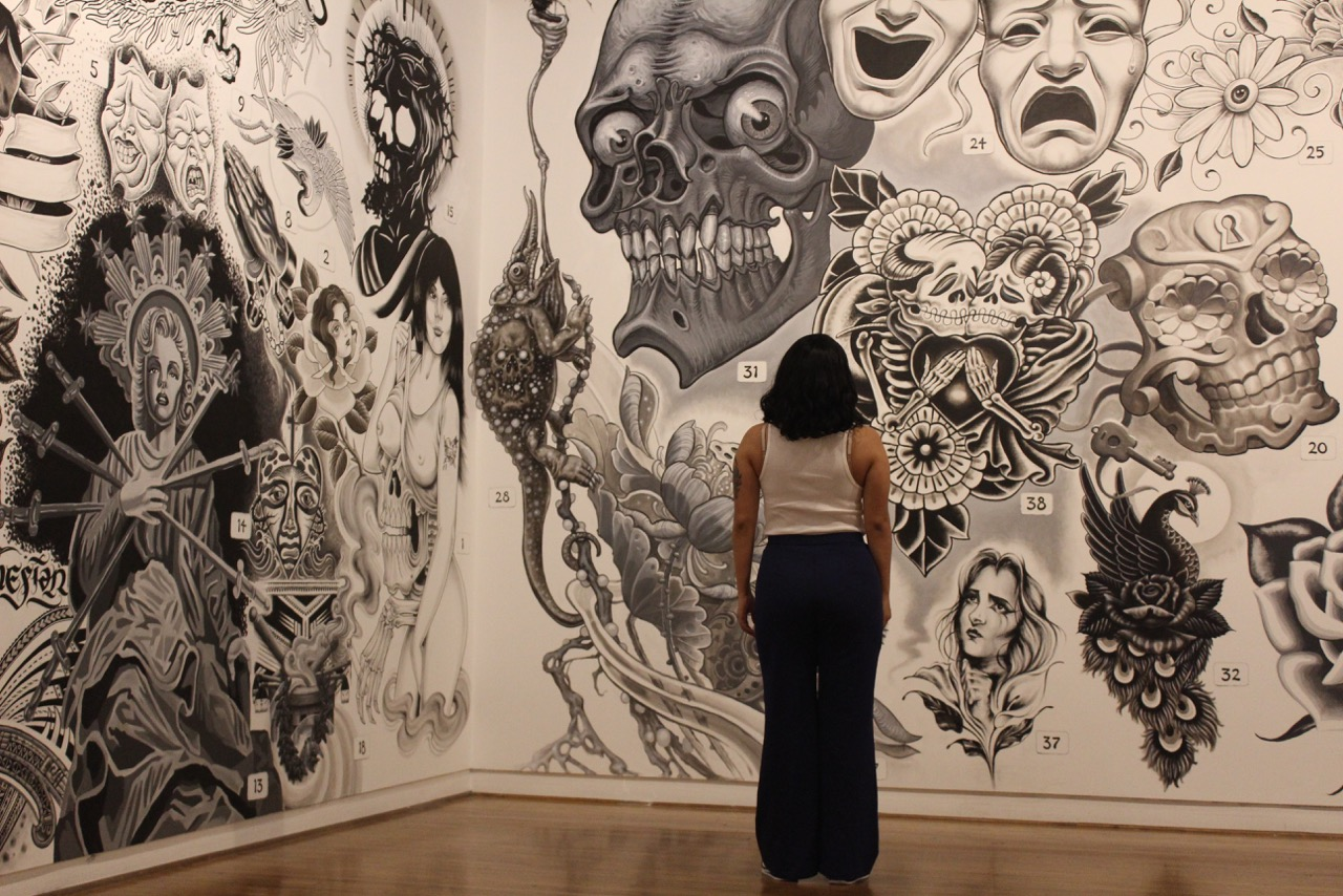 The walls filled with tattoo inspiration.  Photos by: Jocelyn Ruiz