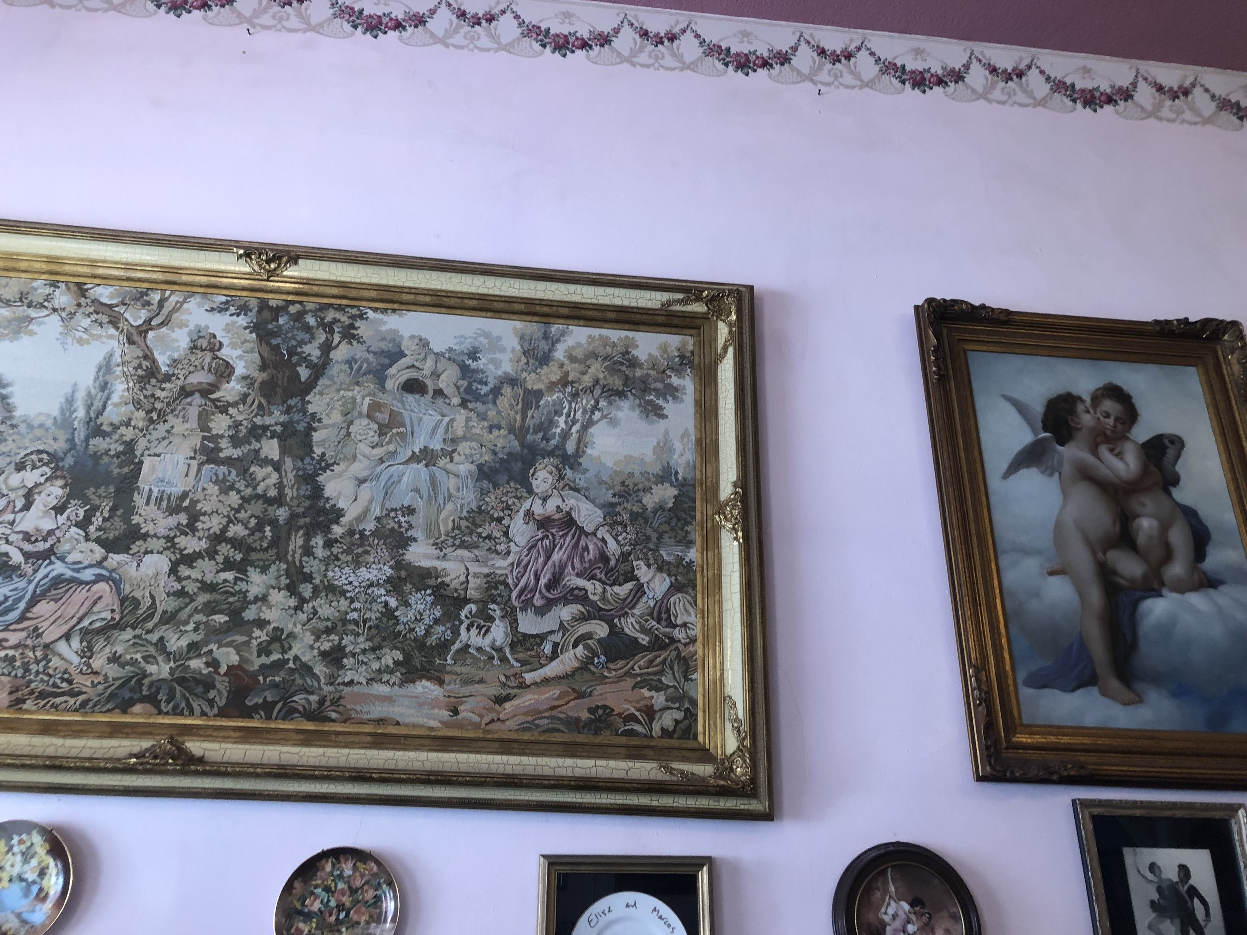 The walls of Elise's Tea Room are decorated in paintings that guests can gaze at while sipping tea.