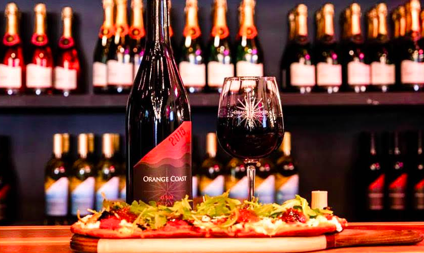 Credit Orange Coast Winery Facebook Page. Orange Coast Winery's Mediterranean Veggie Flatbread pairs well with their entire wine selection.
