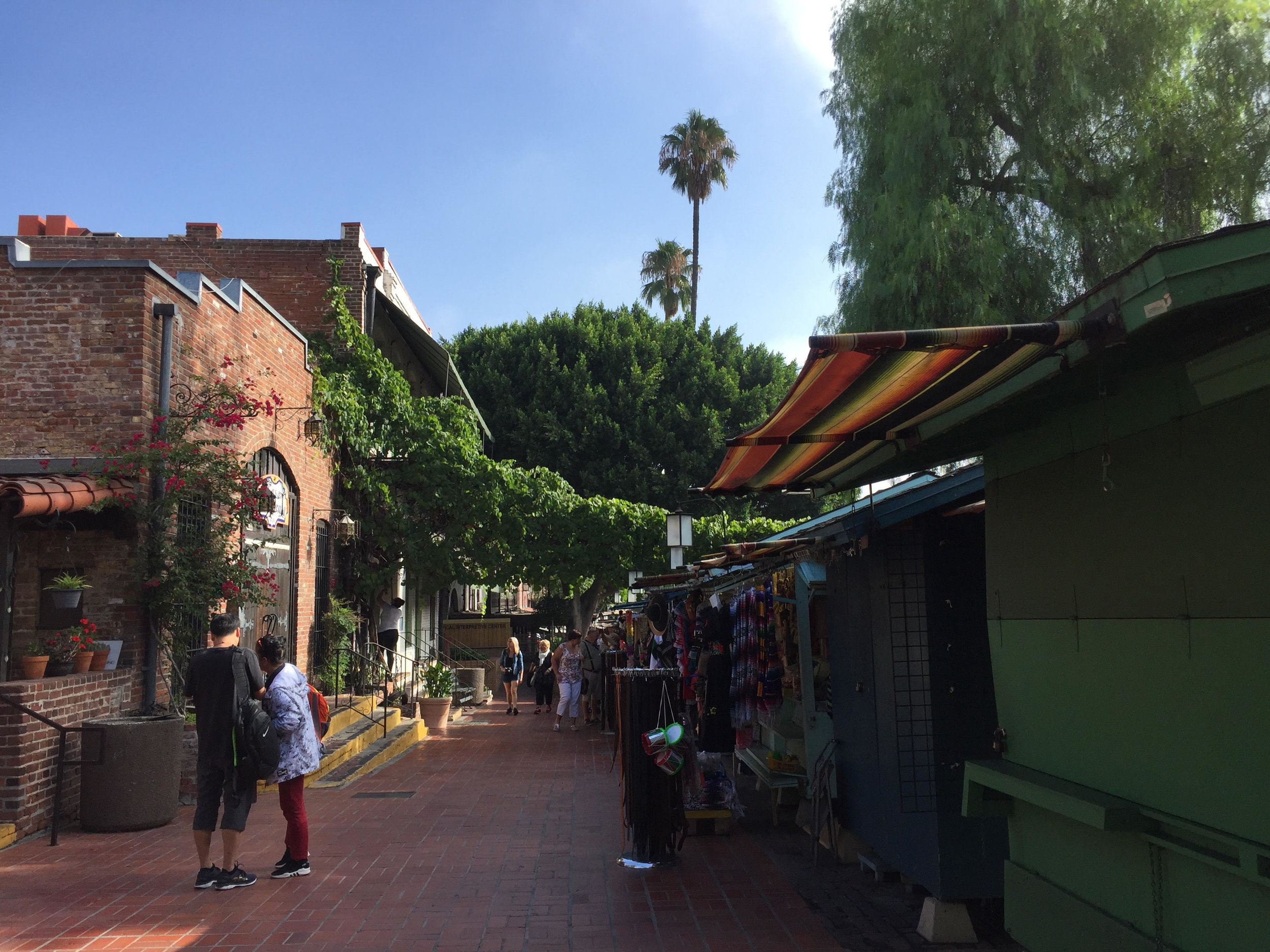 Vendors and small shops line Olvera Street.
