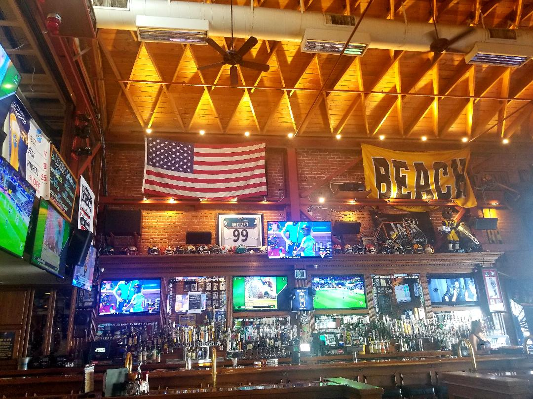 Plenty of sports memorabilia is displayed throughout the bar.