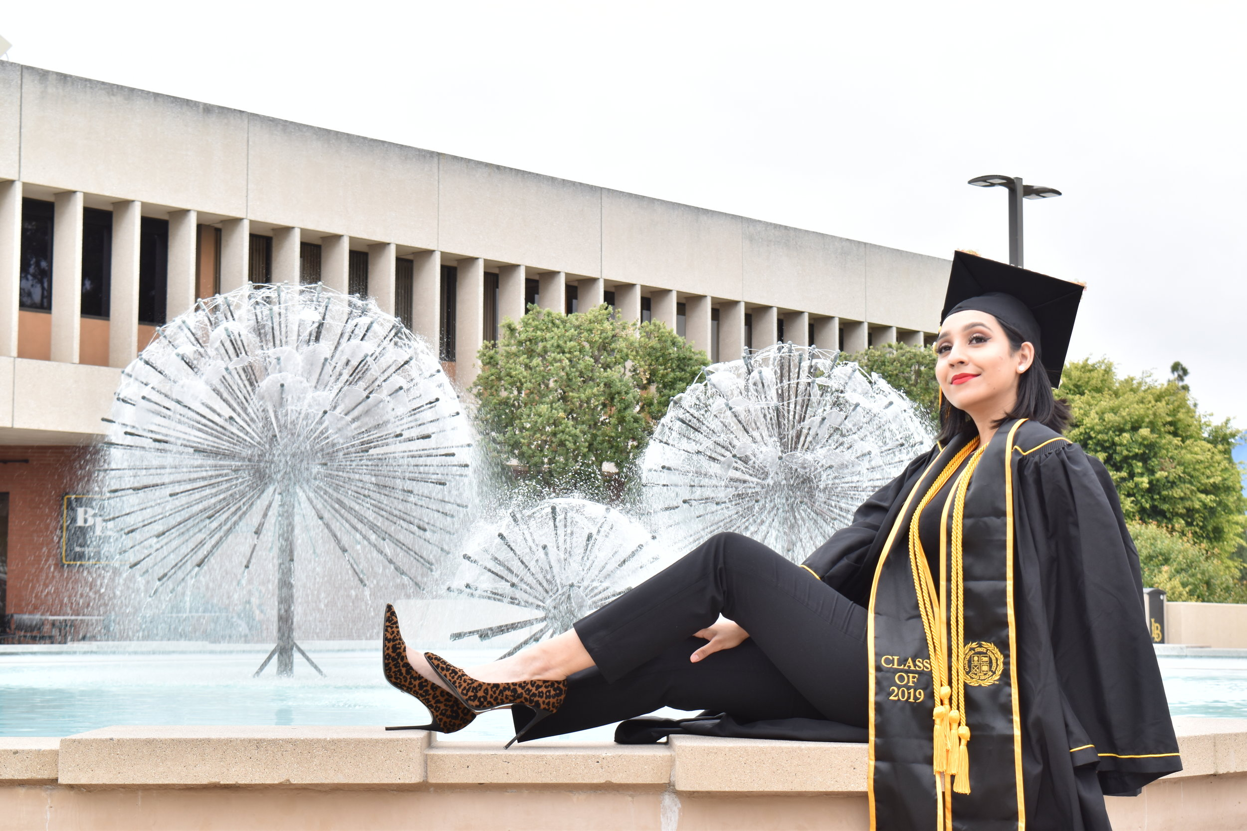 Walking with a Bachelor's degree in Journalism was something I always knew was going to happen, but at times felt insurmountable due to my depression and anxiety. It made this moment all the more triumphant. Photo courtesy of Karla Enriquez.