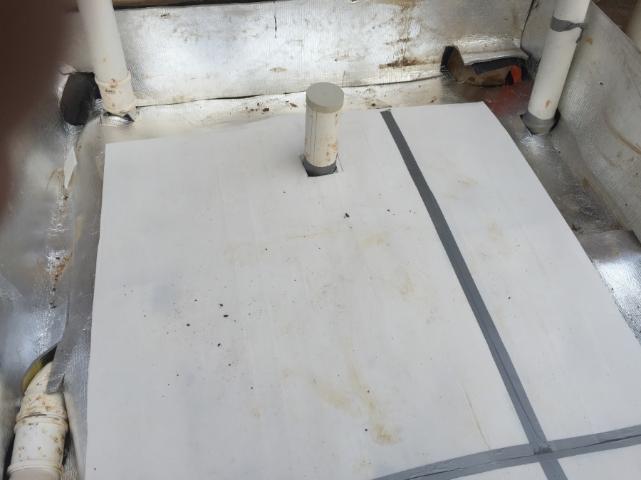 The insulation on top of the black plastic and turned up to cover the concrete yet to be poured, with the corduke on top to increase the efficiency and protect the insulation.
