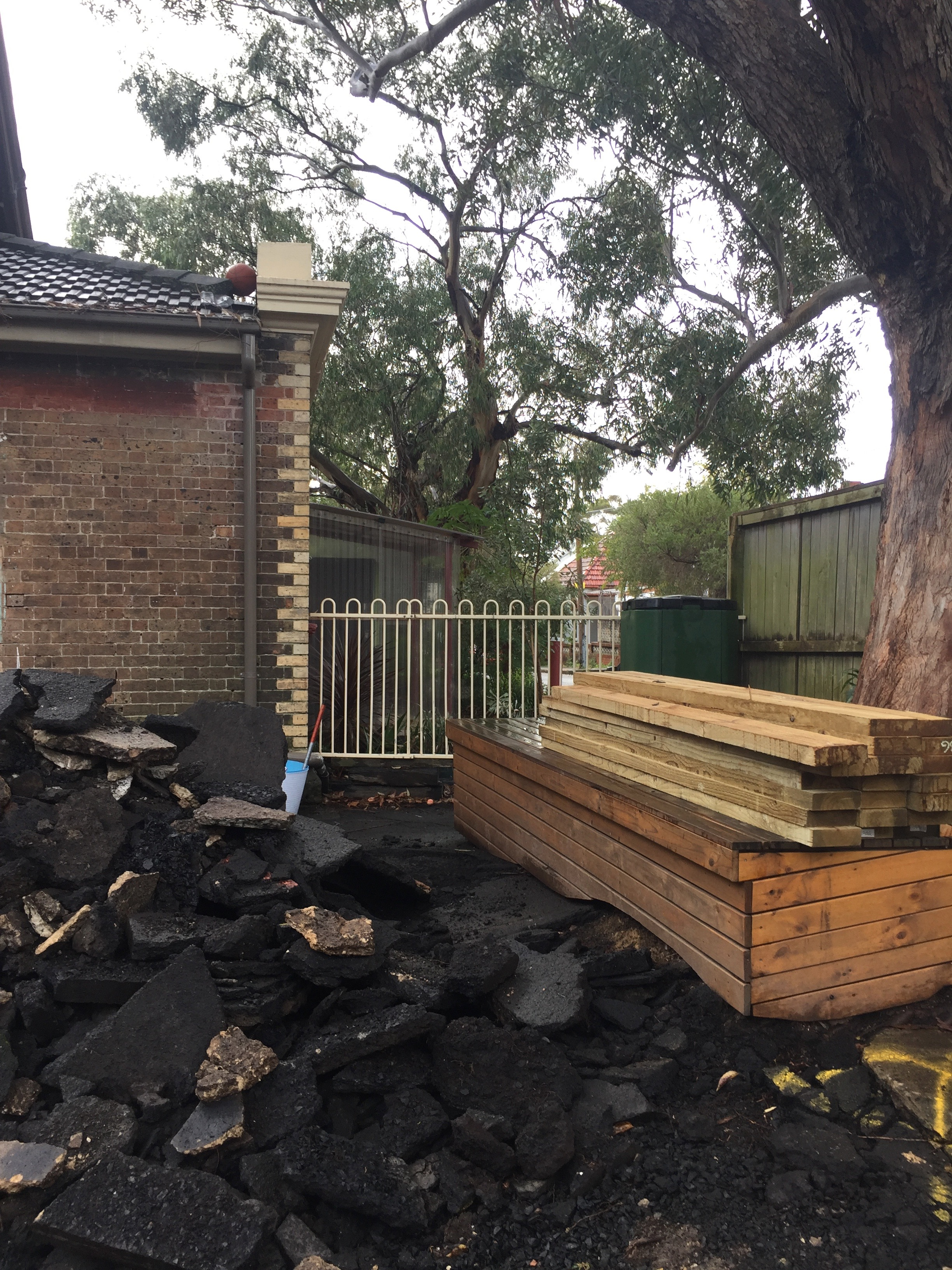 •  Black bitumen being removed from the playground as tree roots had buckled it looking for air and water, and water ponded in it during rain, and the black material was heating up the school