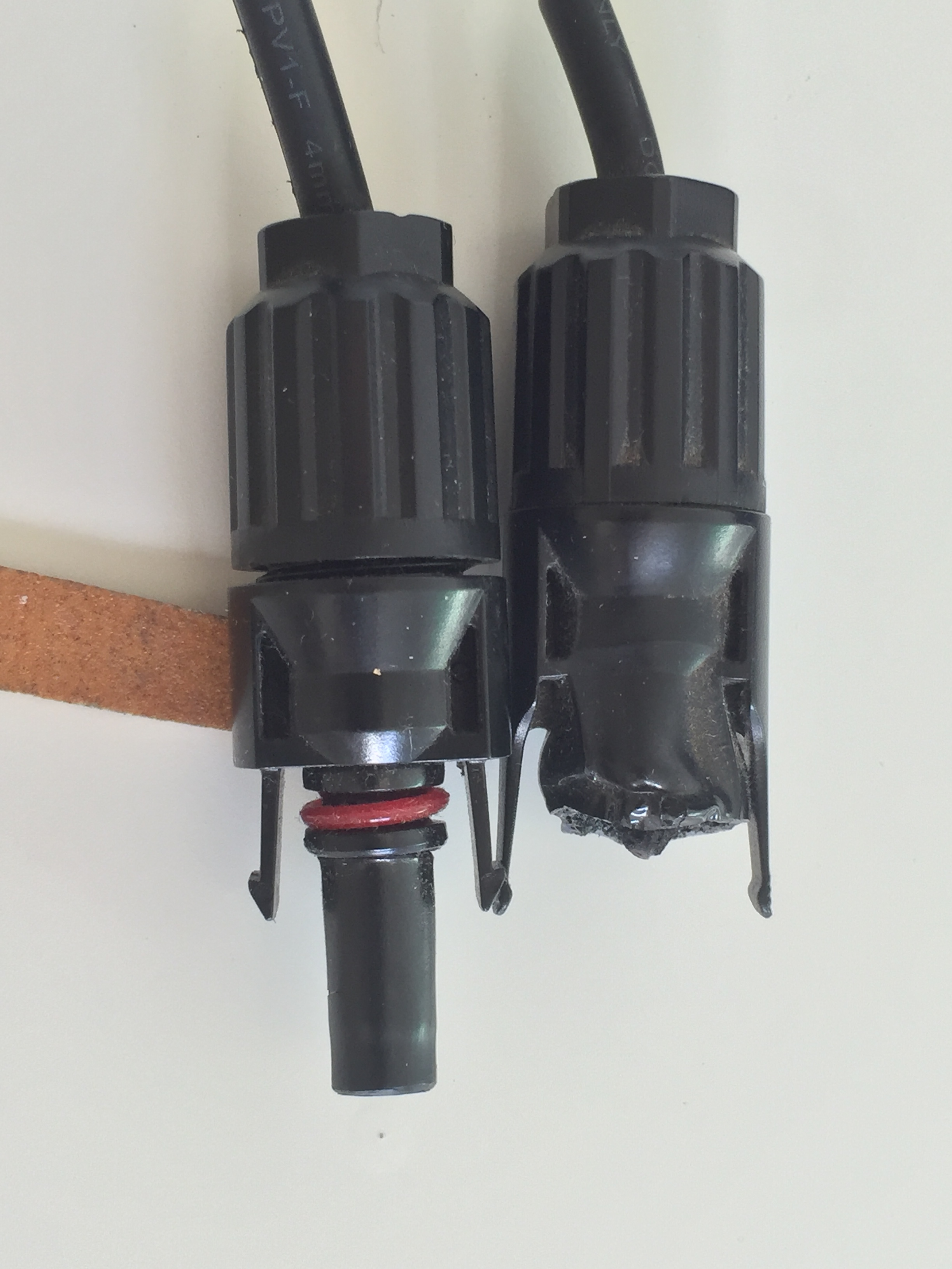 •  On the right: melted, failed connector prevented power going into the batteries