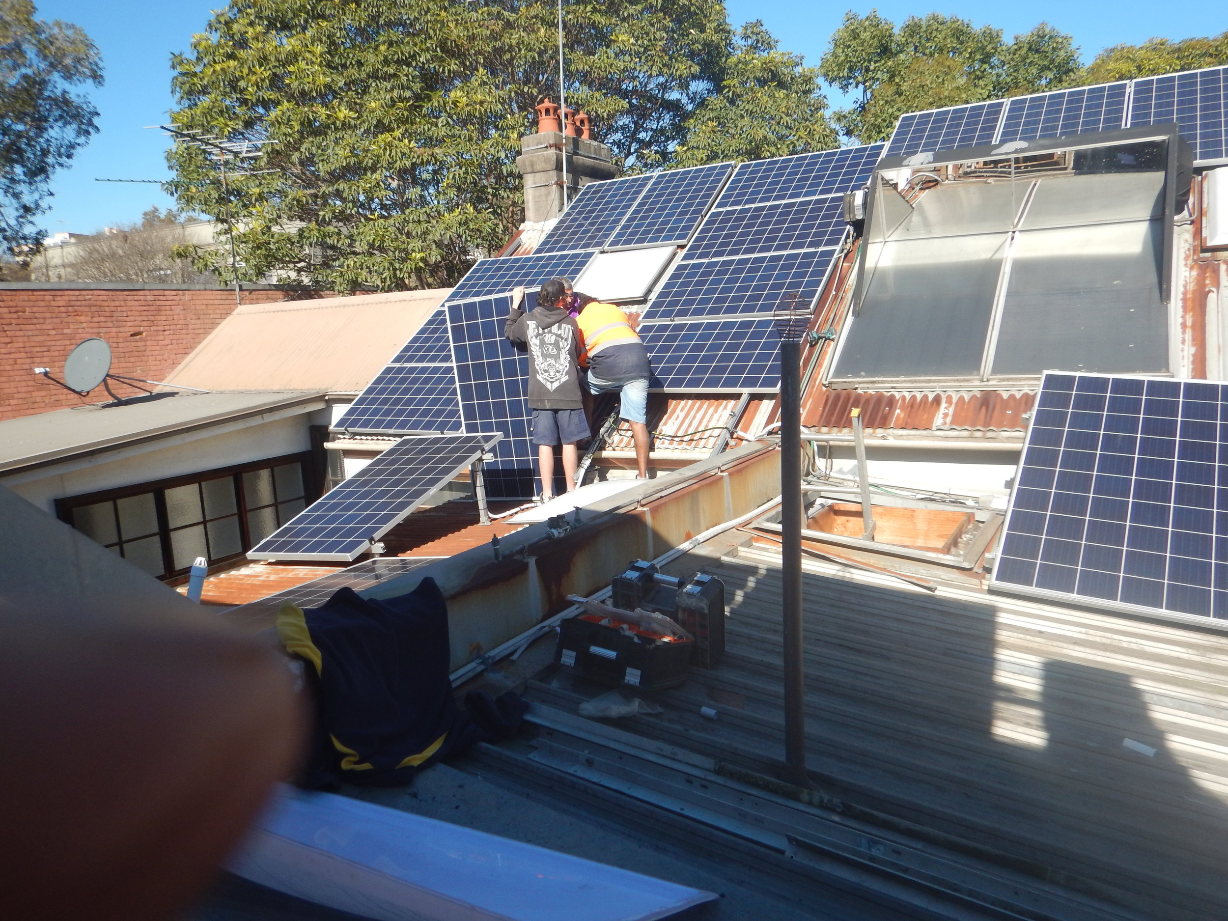 • Left: Neighbour's roof with new panels going on to it; Right: my roof and panels