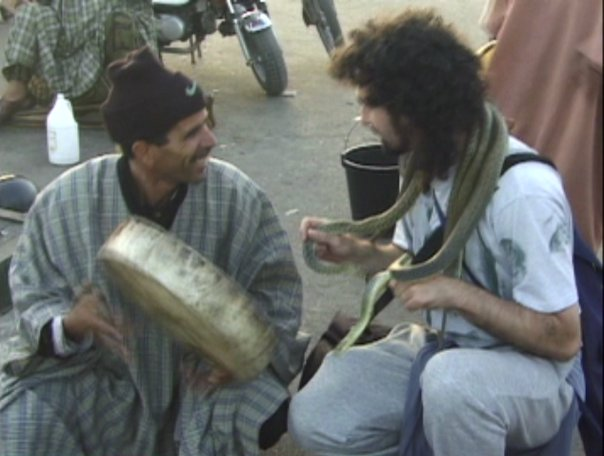 Chatting with a snake charmer in the main Medina in Marrakech, everything was OK till he put the  cobra in my face  :-/  Click anywhere on the image to bring up the lightbox,   roll mouse over the image,and then click on the underlined link in  description to go to the youtube video.