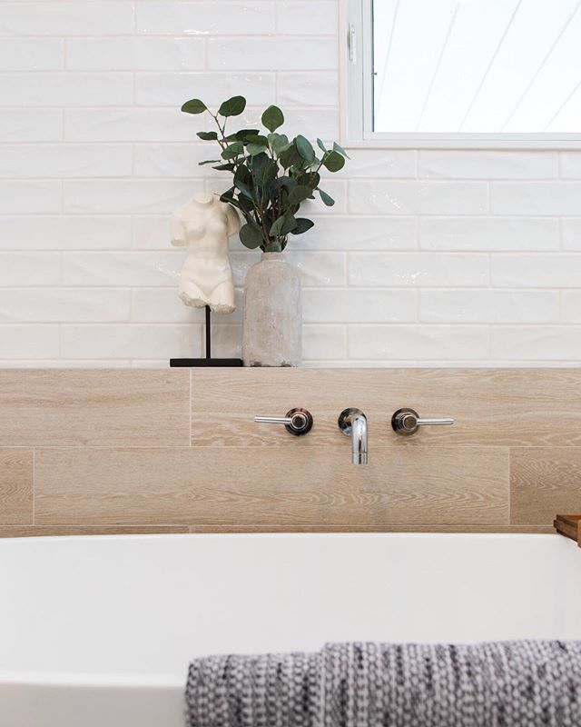 One feature everyone loved about this bathroom from the Springdale bathroom remodel was the ledge right next to the freestanding tub to put all your essentials and eye catching decor!