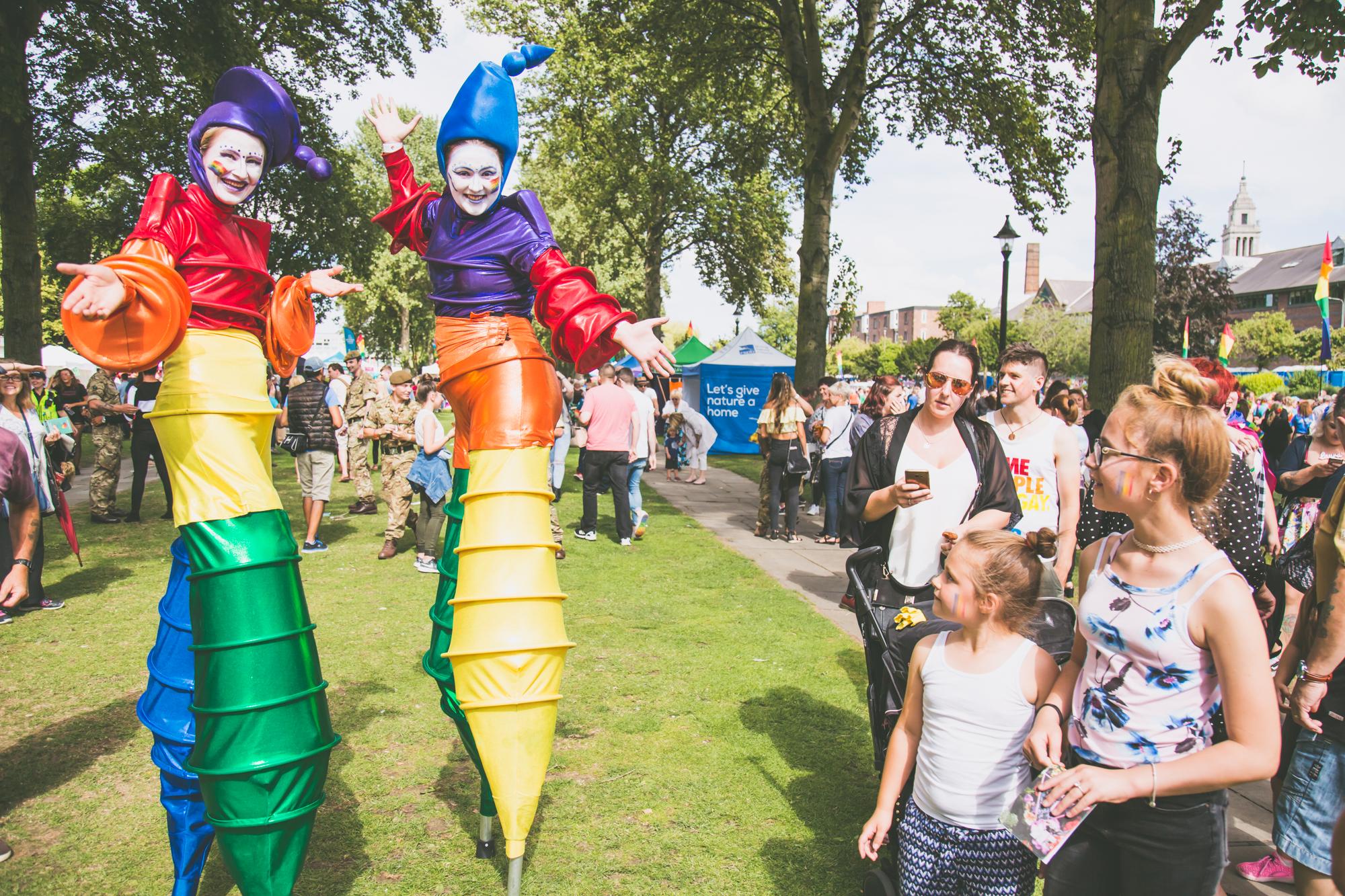 Rainbow stilt walkers at hull pride