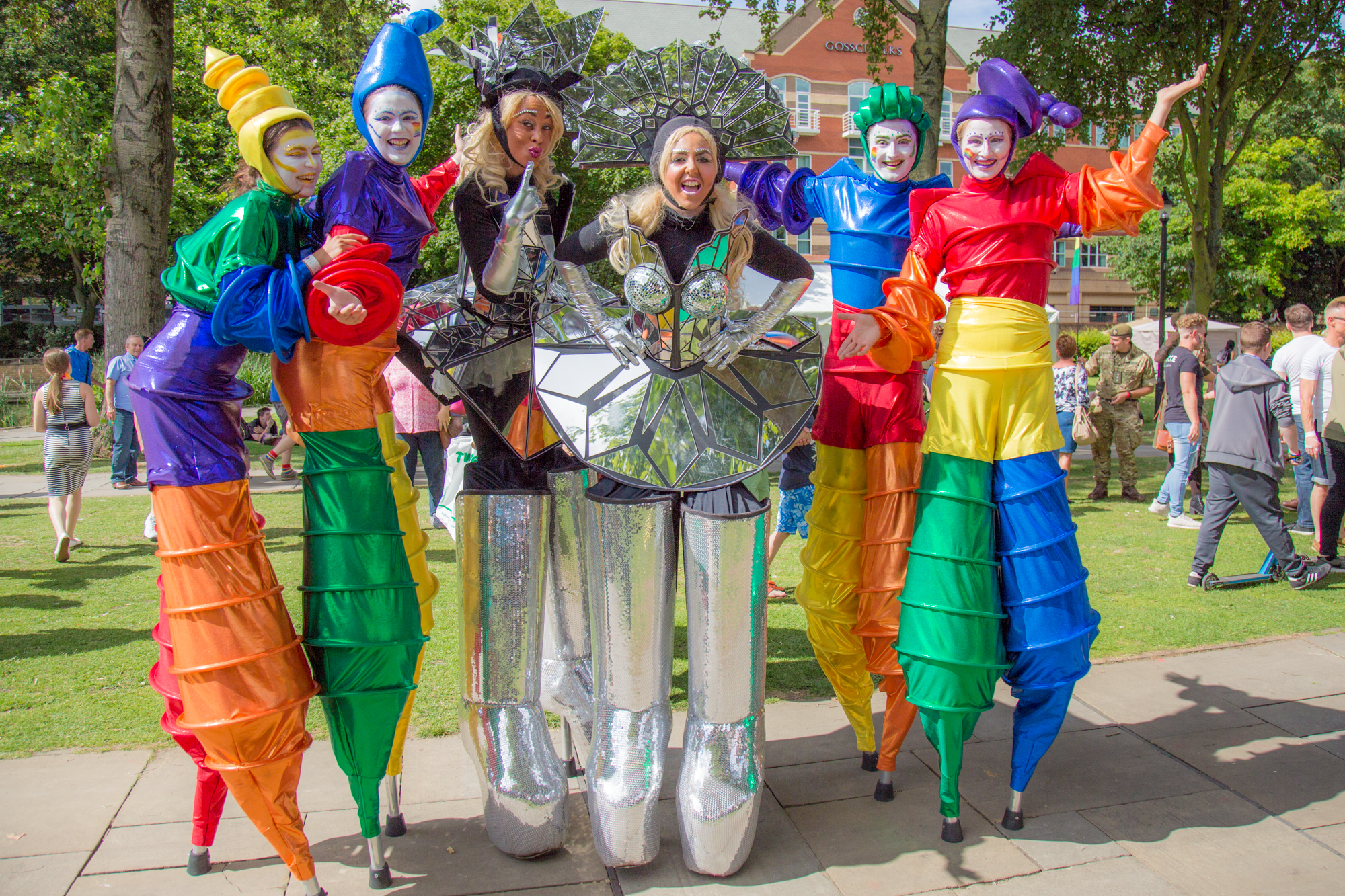 The gorgeous girls and rainbow stilt walkers