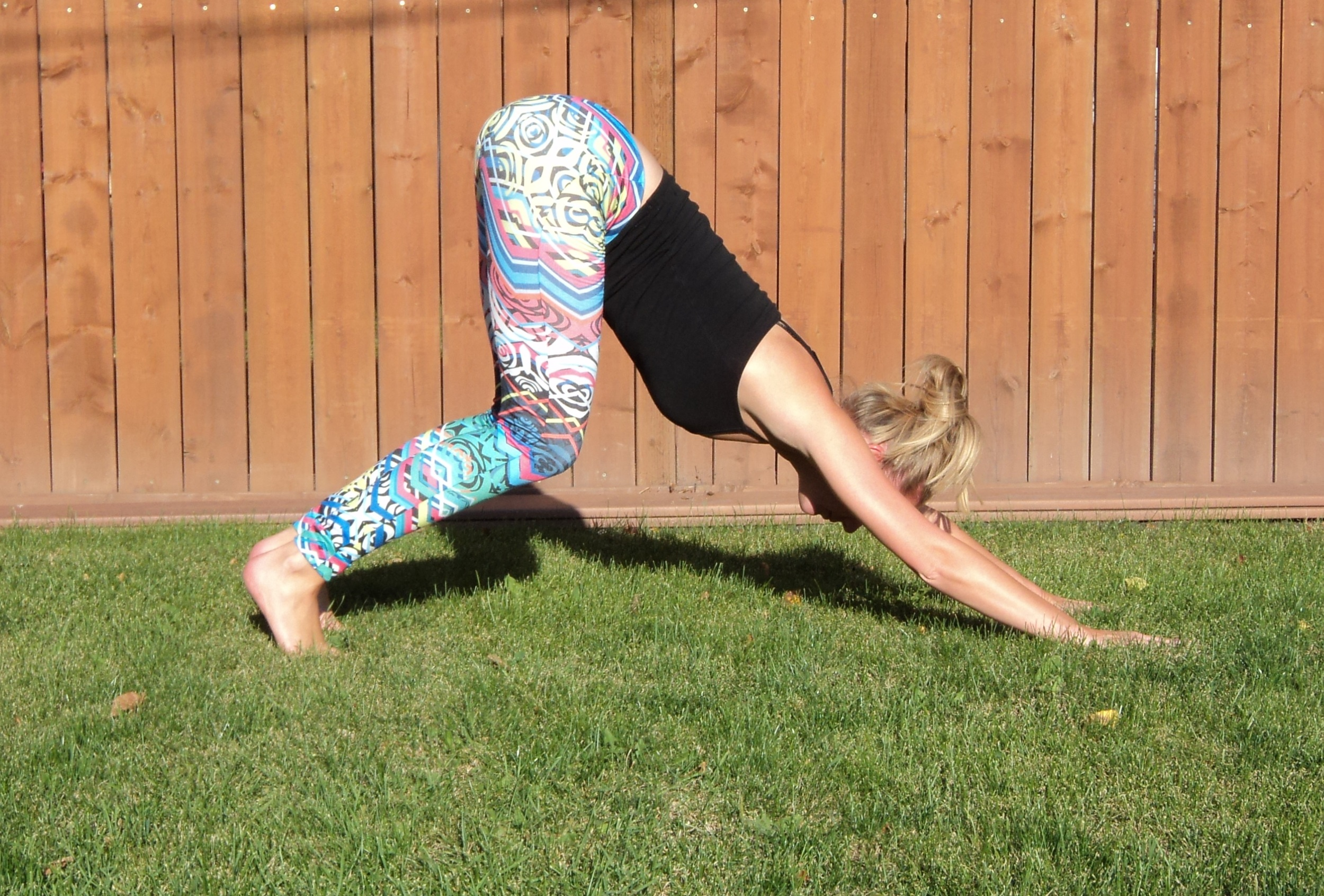 Lift the hips by bending deeply through the knees