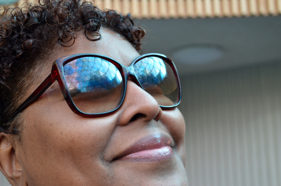 The Center's geodesic dome reflected in Dee's glasses