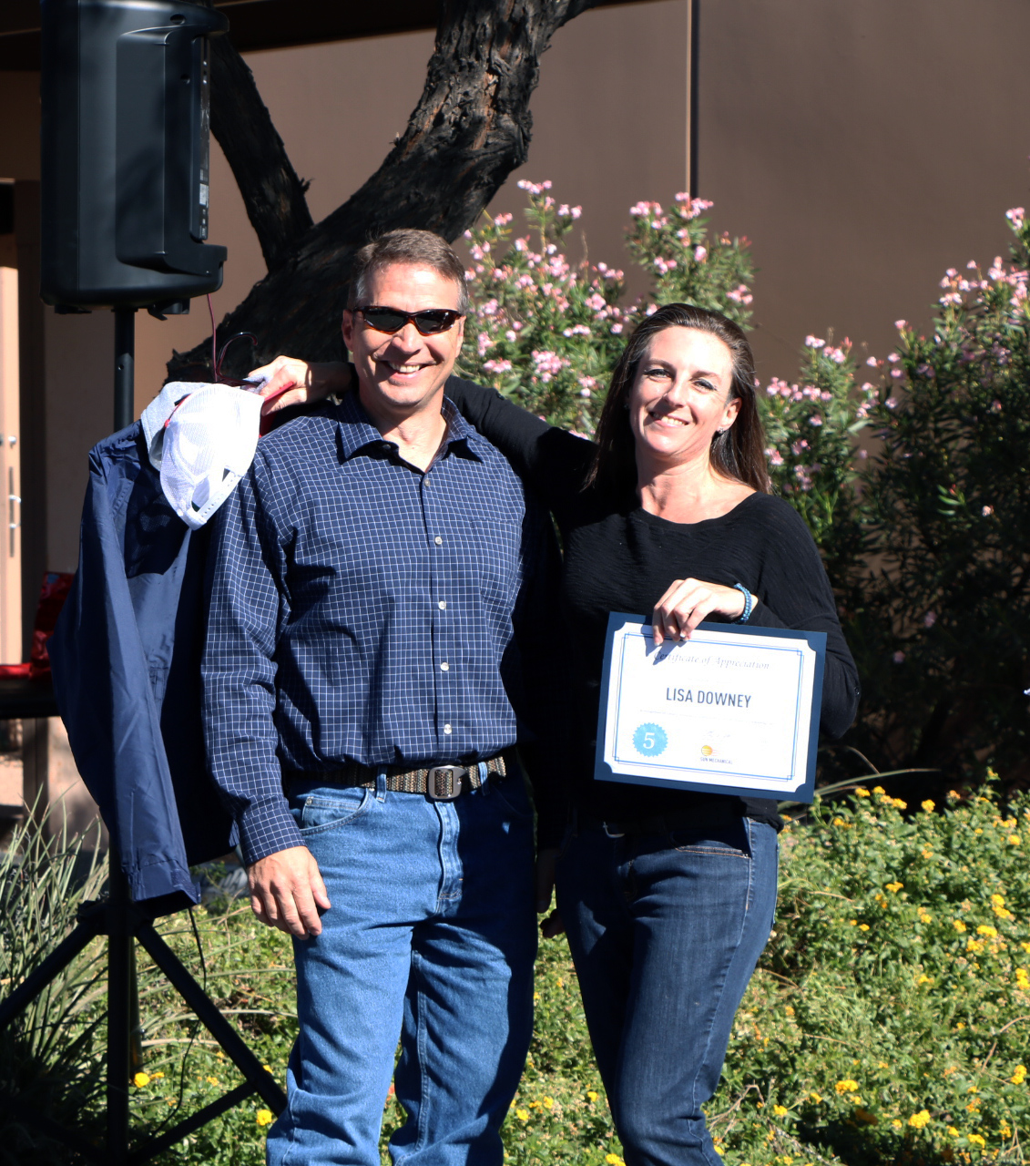 Director of Operations Eric Buchholz and Lisa Downey pose for a picture after she was recognized for her five-year anniversary with Sun Mechanical.