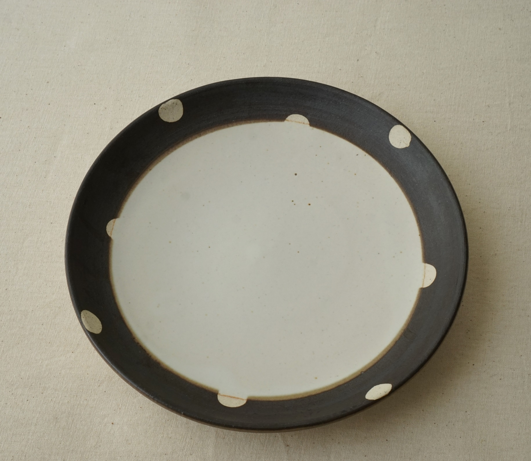 I served crepe on this Dotted Plate.  Perfect for dessert.even great for sandwich, or toast.  Not big ,but not too small.