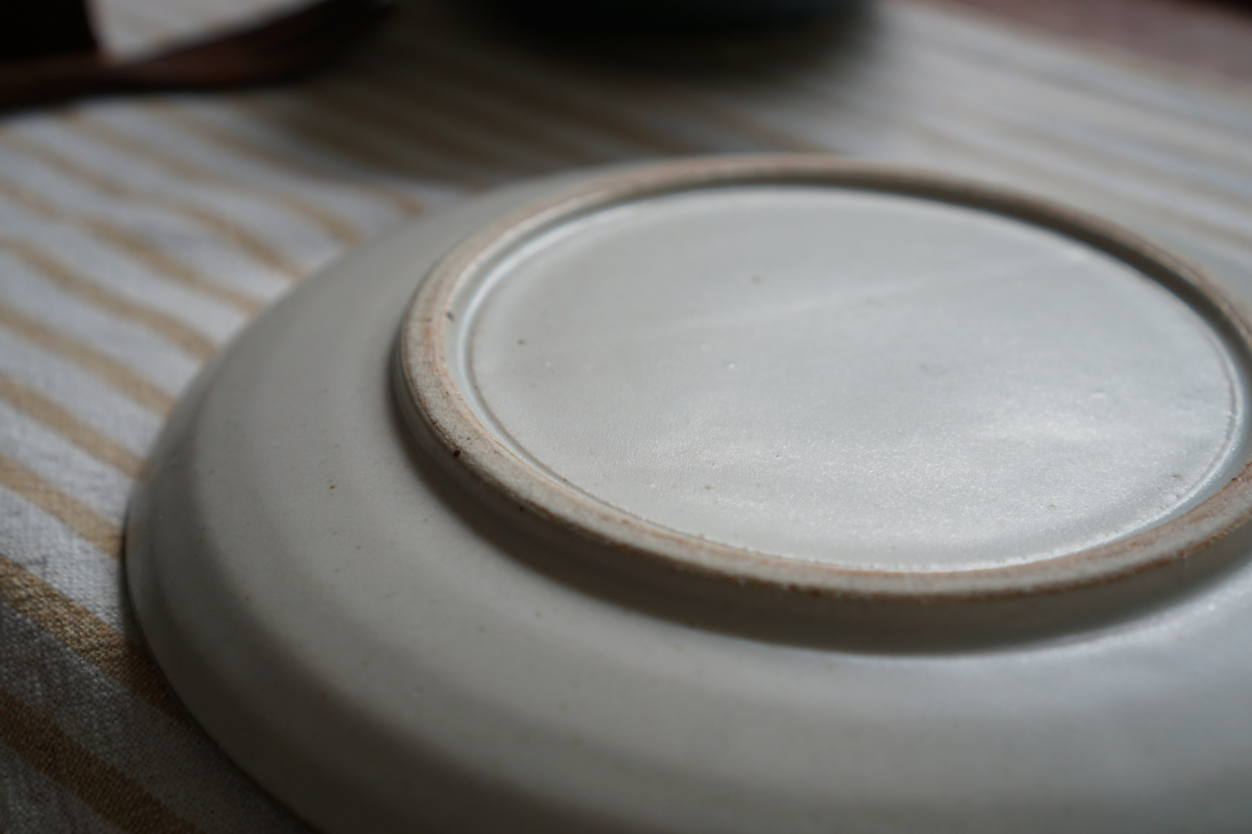 I love this plate's simple rustic beauty.  You will not be disappointed with this plate.