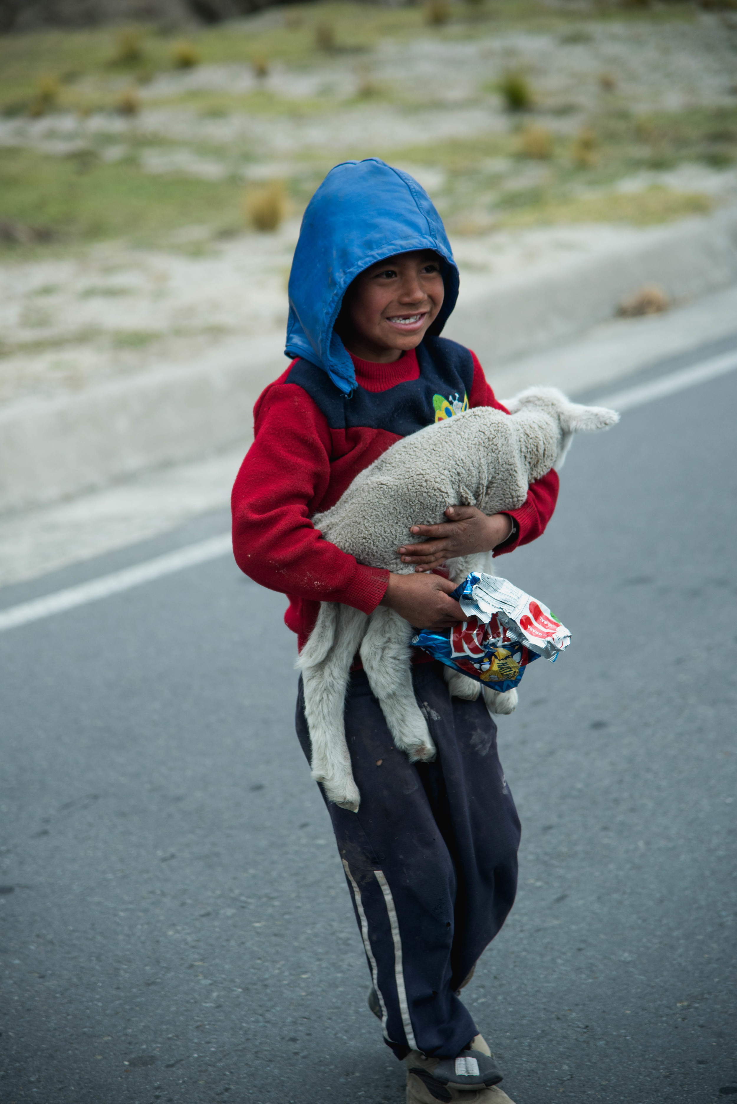 Our driver stopped as we drove past this boy who was sitting on the curb with his newborn lamb. He handed the boy his potato chips and zoomed off while the boy's smile quickly reached from ear to ear.