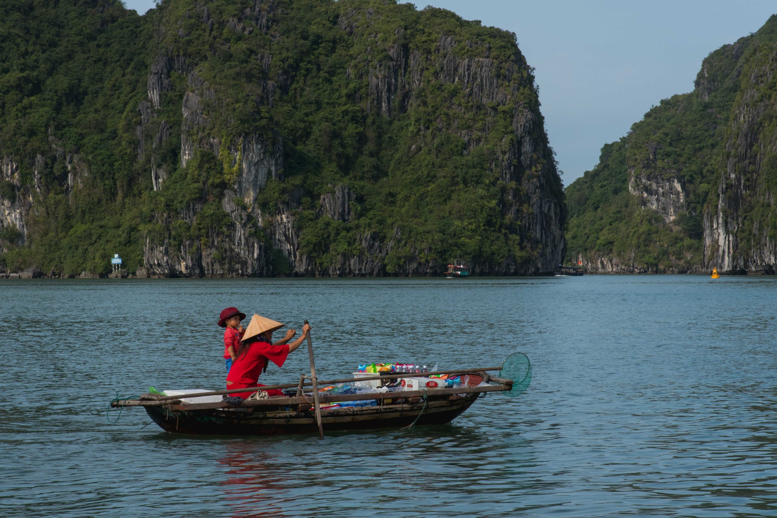Mothers rowed boats around the islands to the cruise ships selling snacks and drinks, a mobile snack bar.