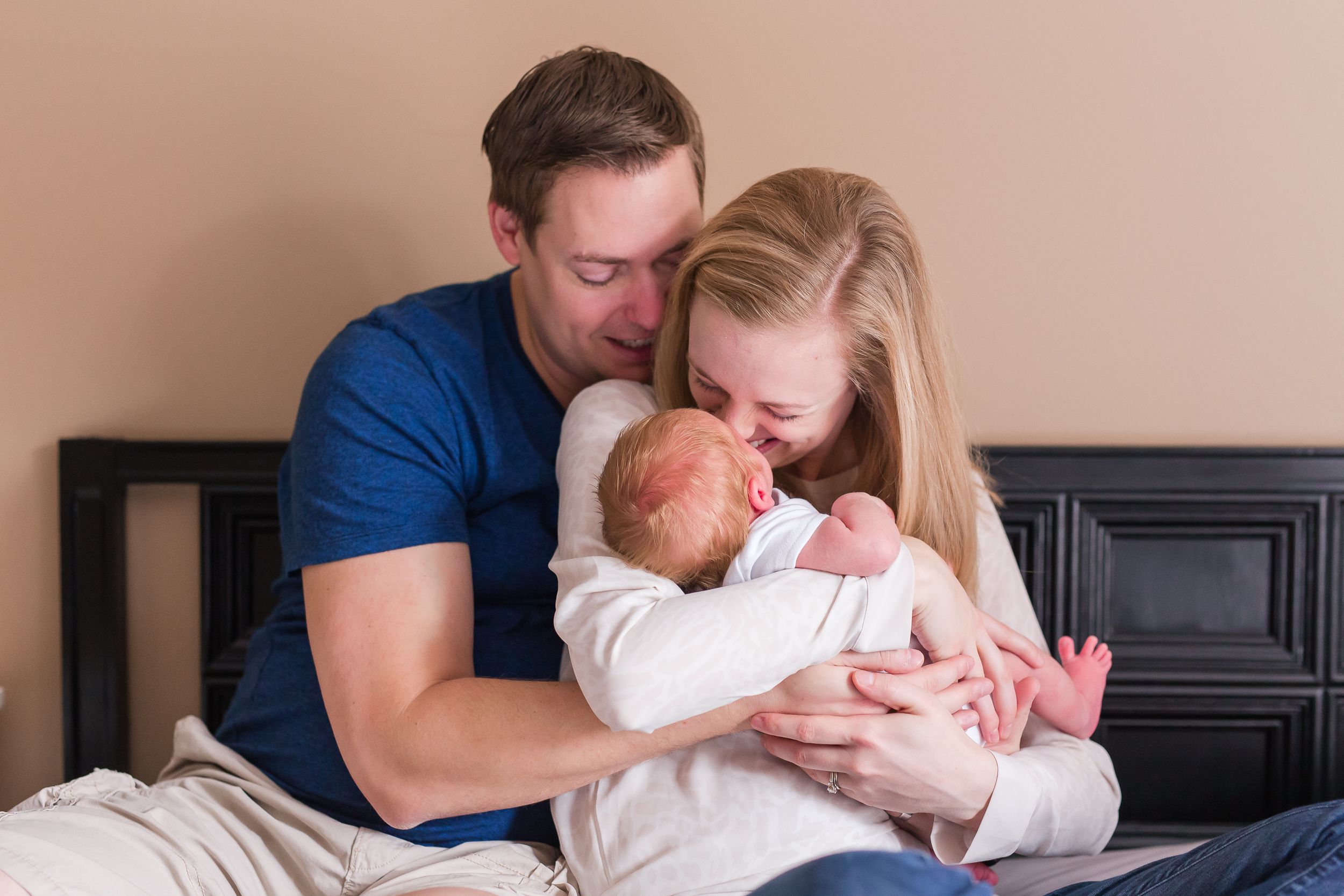 Two week old Connor with his parents at his in-home newborn session.