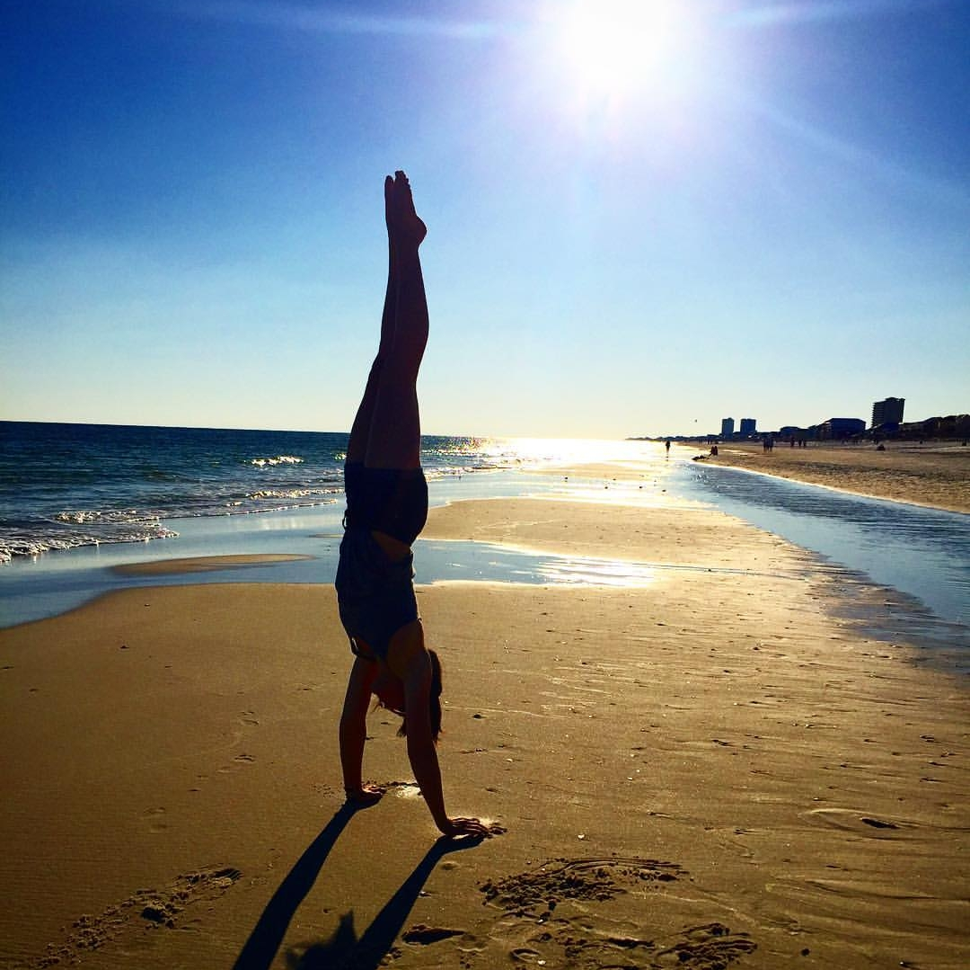 There's a 90% chance you'll find Lori in a handstand anywhere you see her.