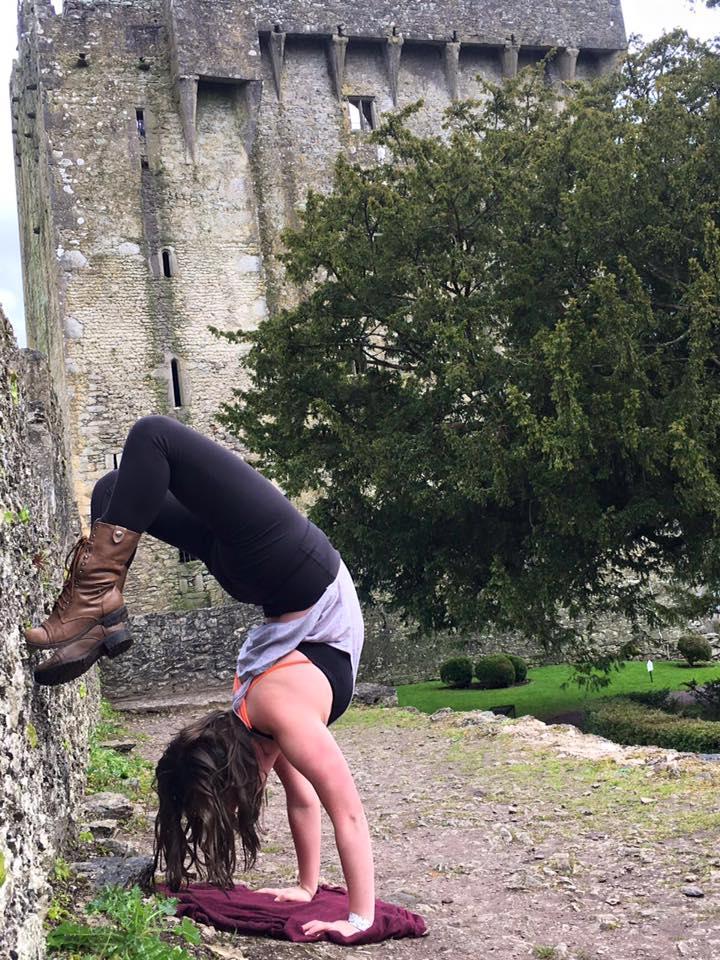 Jamie bending over backward on her trip to Ireland.