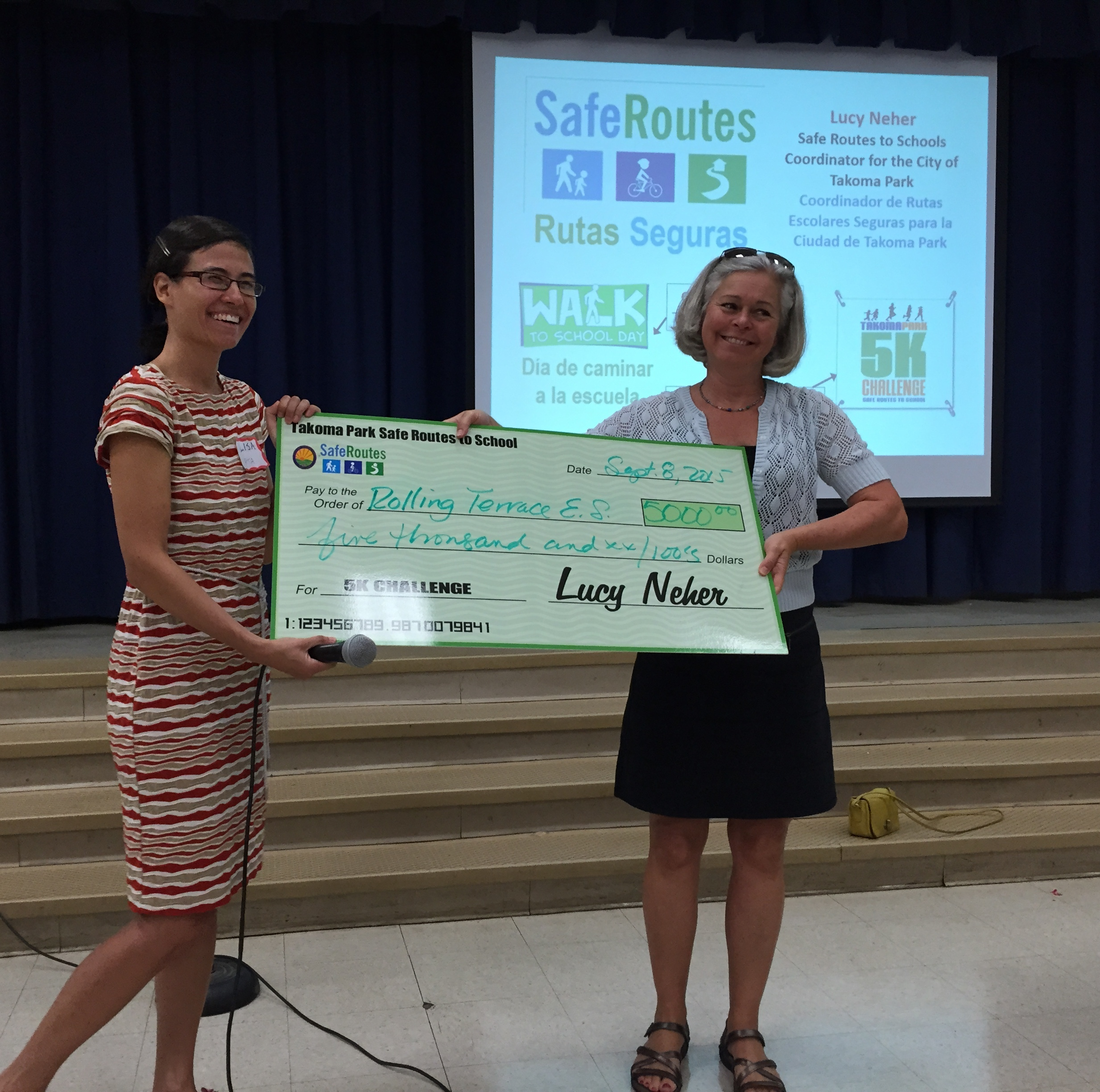 PTA meeting, PTA President, Lisa Seigel, received a $5,000 check from Lucy Neher, Safe Routes to Schools Coordinator for the City of Takoma Park.