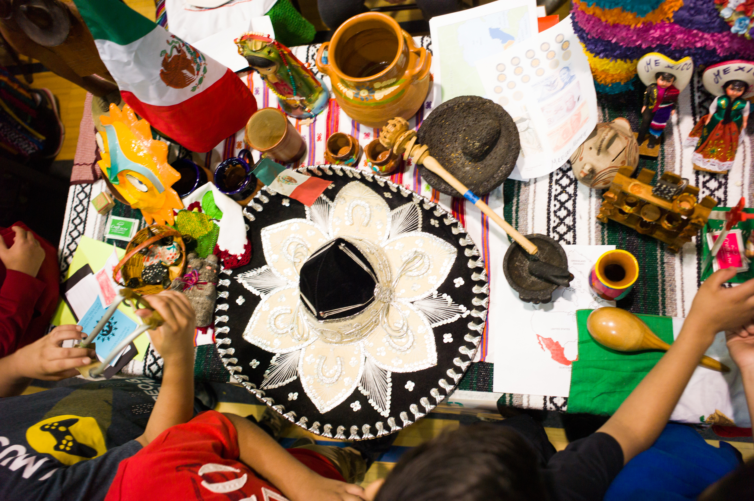 The Mexican table overflowed with colorful items showcasing the country's culture.